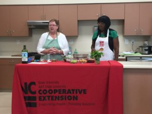 two women conducting extension master food volunteer training