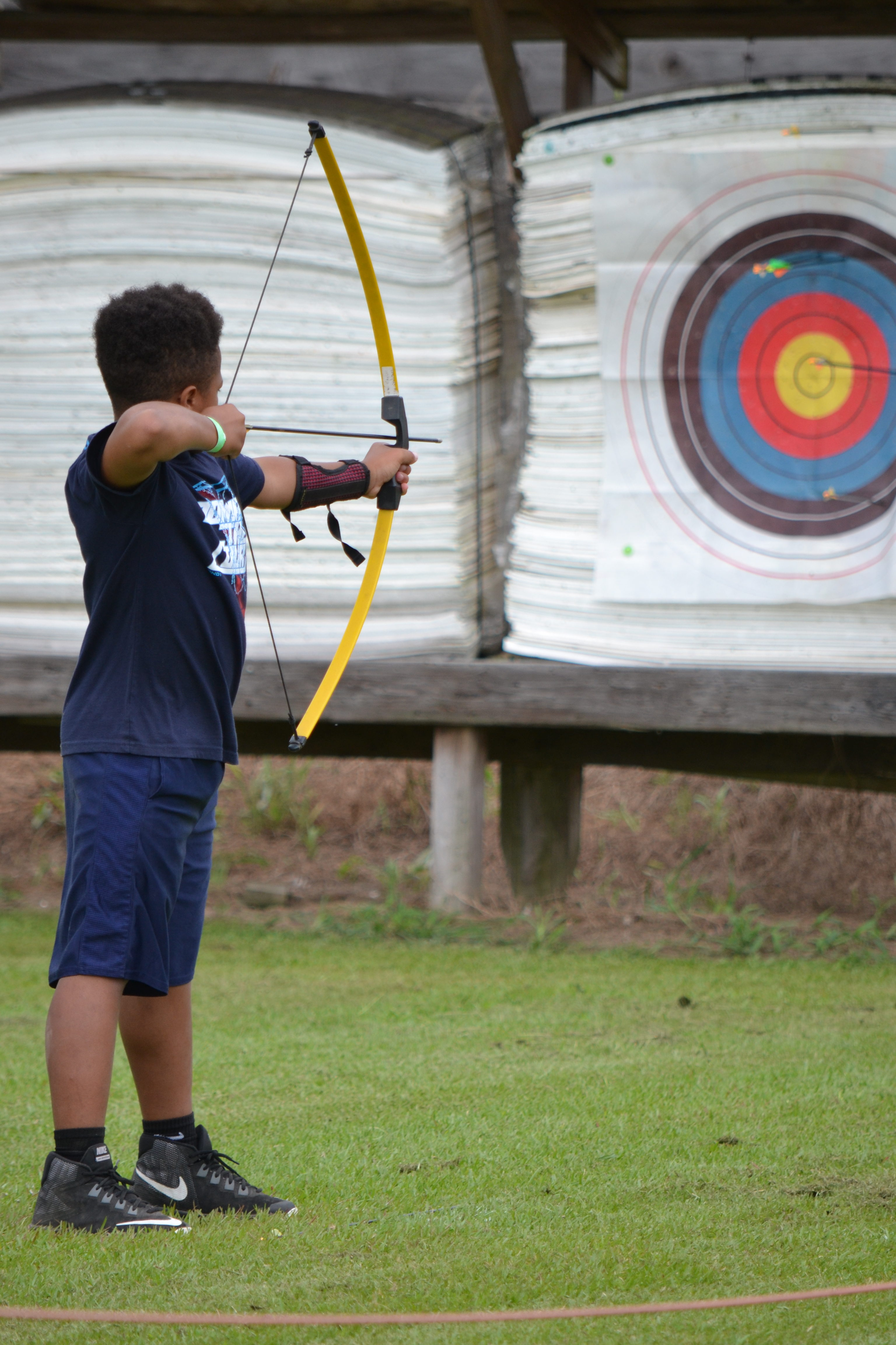 Image of boy shooting arrow