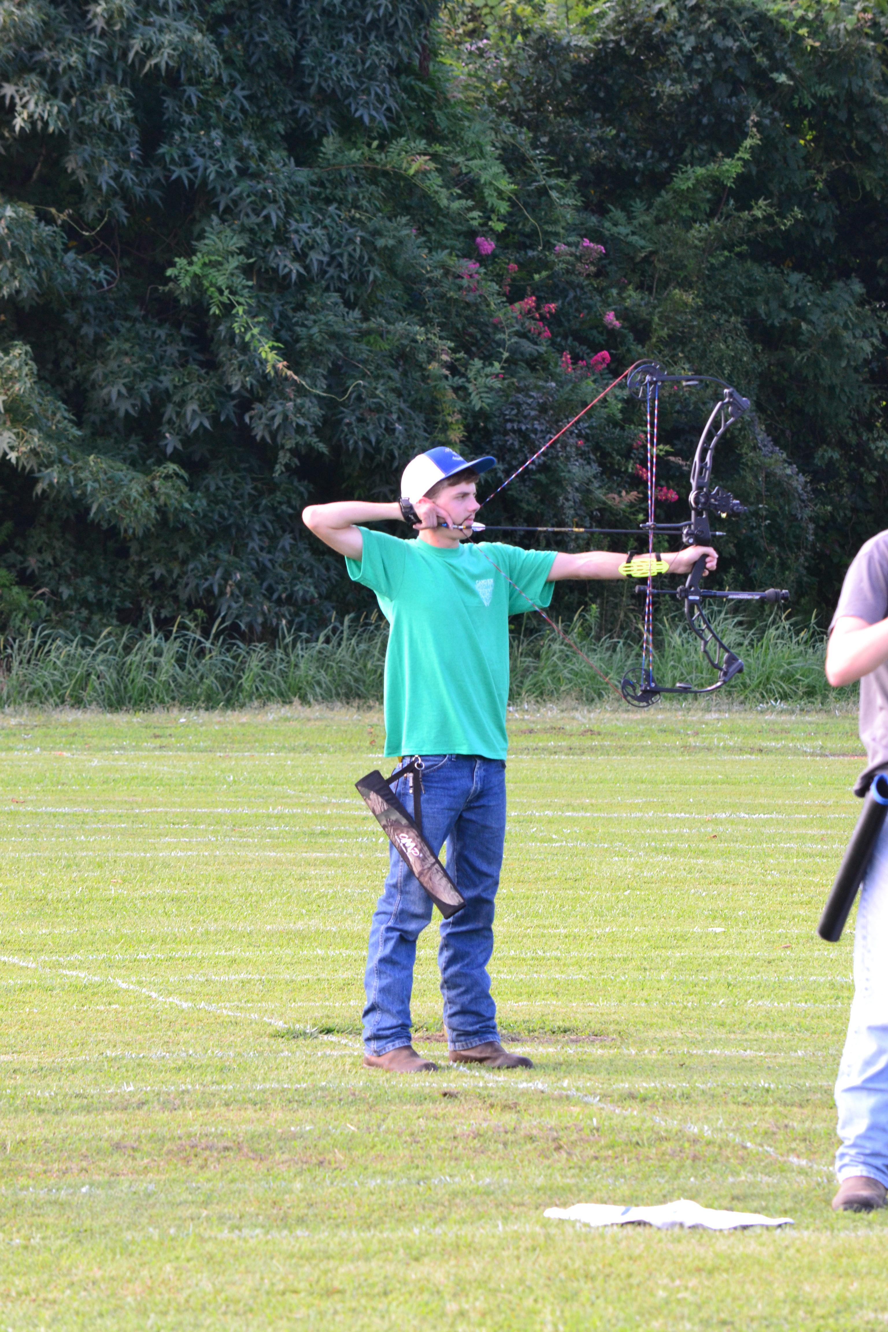 boy shooting bow