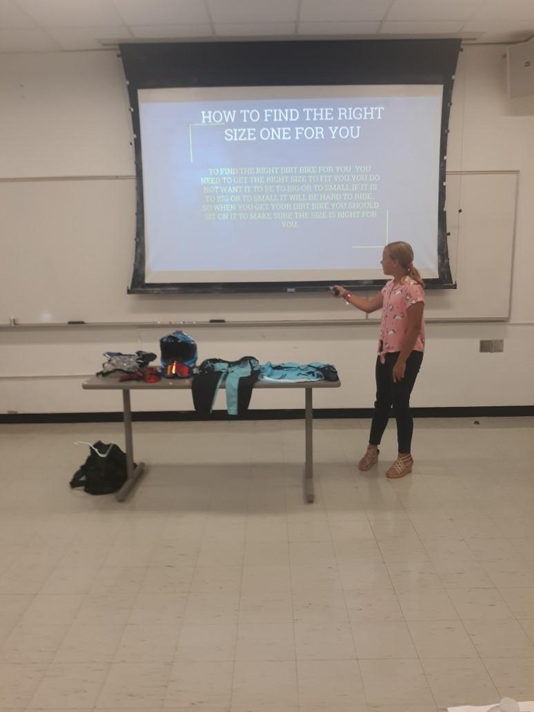 Sadie Herzelfdt presenting
